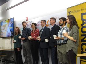 This group of students competed in the WVU LaunchLab's Show of Hands pitch competition, including Courtney Burgazli, Joshua Lohnes, Ashley Reece, Johnny McFadden, Andrew Wilson, Nima ShahabShamir, and Allison Sommer.